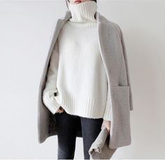 So minimal and stylish. We love this white turtleneck sweater paired with a grey coat.