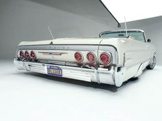 Google Image Result for http://images.lowridermagazine.com/features/0605_lrm_02z%2B1964_chevy_impala_convertble%2Bback_shot_of_car.jpg