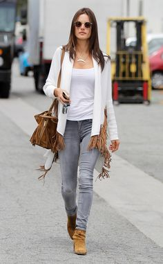 Groovy Goods from Celebrity Street Style  It's no secret Alessandra Ambrosio has a flare for '70s style, and she once again demonstrates it in this white cardigan fringed with a coordinating fringed tote and circular shades.