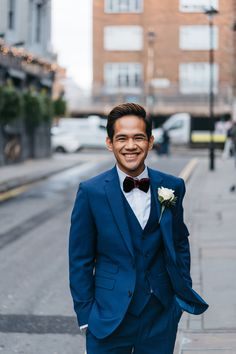 Blue Wedding Suit for Groom with Burgundy Velvet Bowtie | By Miss Gen Photography | Elopement | City Wedding | Town Hall Wedding | Gay Wedding | London Wedding | Blue Wedding Suit | Groom and Groom | Mr and Mr | Intimate Wedding | Small Wedding | City Elopement | Brown Shoes for Groom | Groom Wedding Suit Blue Wedding Suit Groom, Wedding Blue, Wedding Groom, Wedding Suits, Groomsmen Suits, Small Intimate Wedding, Looking Dapper, London Wedding, Town Hall