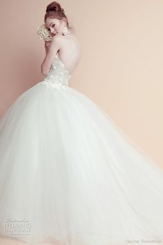 Beautiful wedding dresses by Oliver Tolentino. You may have seen the filipino designer's creation worn by Amber Riley at the 2011 Golden Globes. Love the romantic ball gown with appliqued bodice.