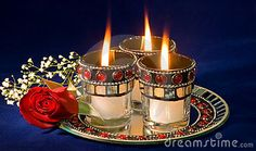 Candles and rose bud by Ken Cole, via Dreamstime
