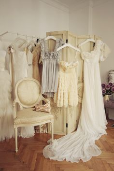 Cute idea for a pic of the dresses hanging up before the wedding!
