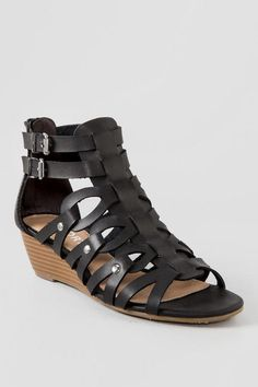 "The Midori Demi Wedge Sandal is the go to sandal you need. This sandal has a small demi wedge with an adjustable ankle strap and back zip. The Midori Demi Wedge Sandal have an easy wedge for comfort and can be worn with your favorite dress, jeans or shorts for a variety of looks.<br /> <br /> - By Report<br /> - Imported<br /> - Manmade upper<br /> - 1. 75"" stacked demi wedge heel<br /> - Adjustable ankle straps"