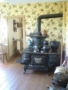 Old farmhouse stove/.'we' do not have to go this far (this is spectacular) to create a farmhouse lifestyle kitchen.would'nt turn the stove down though!