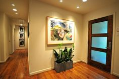 contemporary entry by Valerie McCaskill Dickman  Front door and lights down the hall!