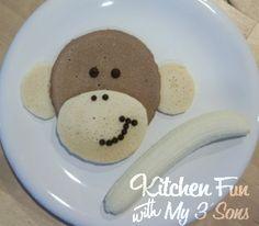One chocolate pancake, One regular pancake, chocolate chips, and a banana.  So cute for kids breakfast.