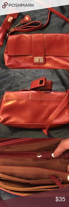 BNWOT Red Nine West Purse Super cute Red Nine West purse.  It has a lipstick holder, key tag and an adjustable strap.  Perfect for the upcoming holiday season!!   Make me a reasonable offer. Nine West Bags Satchels