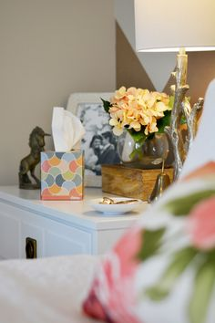 White nightstand, brass unicorn, floral watercolor pillow, branch lamp, chevron wall, and #KleenexStyle on Mae Amor