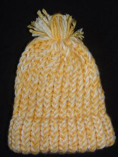 Yellow and White Knitted Baby Hat with Brim with a small pom-pom on top