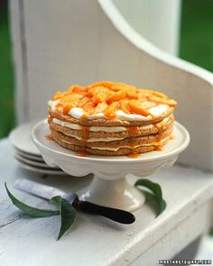 Peach Icebox Cake #recipe --  Ground almonds, sugar, and egg whites make the chewy, macaroonlike layers of this lovely cake. The layers are brushed with peach schnapps and spread with a mascarpone and whipped cream mixture, followed by peach puree. Refrigerate the assembled cake for at least an hour before topping with caramel-peach sauce.