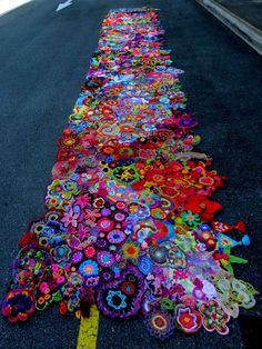 To celebrate the 50th anniversary of the coining of the expression 'Flower Power', over 200 crocheters and knitters from 24 countries created freeform motifs with a hippie theme. They mailed them all to me, I joined everything together, and this is the result. You can also see photos of all of the the individual pieces that went into it, and where they came from, on the blog http://50yearsofflowerpower.
