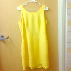 Yellow dress Brand: B.J. & Co. The slip slightly hangs but it you take it to the dry cleaners or you know how to sew, you should be able to wear it. I absolutely love this dress but it no longer fits me as it used to. This dress is dry clean, do not wash at home as I did. Dresses Midi