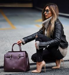 Aditi Oberoi Malhotra + leather jacket + chunky knit turtleneck sweater + ripped black jeans + pair of striking nude stilettos + statement handbag + capture this look.  Brands not specified.