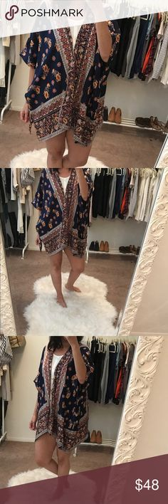 "Angie Navy Floral Kimono Angie Navy Floral Kimono.  Navy printed floral kimono.  Wear as a cover up or over any outfit to complete the look.  Measurements- 27"" length from shoulder hem to bottom.  Bust 36"" closed position and across.  Measured lying flat without stretching. Angie Swim Coverups"