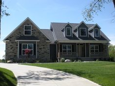 country ranch w/ faux dormers and side entry garage