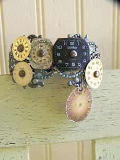 Steampunk Bracelet Vintage Altered Watch Face Bracelet Filigree Bracelet Vintage Ornate Charm Bracelet Cuff Bracelet. $34.00, via Etsy.