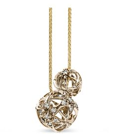 Coppernicus Collection by H.Stern. Pendant in 18K polished Noble Gold with darkened finish and white diamonds. Yellow gold chain.