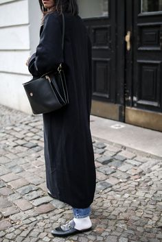 1fe79f87f4e storm wears gucci slipper with white socks a long black coat and chloé faye  bag in berlin street style