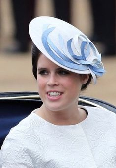 Princess Eugenie's elaborate headwear was designed by Sarah Cant