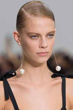 Salvator Ferragamo   - HarpersBAZAAR.com  Runway - Baroque #Drop #PearlEarrings Coco Chanel was rarely seen without a heaping pile of pearls around her neck. With her imitation pearls and gold, she was the innovative one that brought faux jewelry into mainstream fashion.