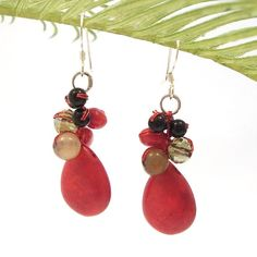 Dangle these earrings to complement any outfit. These earrings handmade from Thailand features red coral teardrop accented with onyx and agate stones on sterling silver hooks.