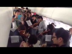 Airplane Orchestra Musicians Perform for Passengers on Flight Delay Philly Orchestra Philadelphia