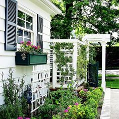 Trellis Ensemble - Narrow areas don't always mean there's no room to build. Here, an ensemble of three structures--a small-grid trellis, a larger L-shape trellis for privacy, and a gated arbor--all fit in a side yard that's only several feet wide.
