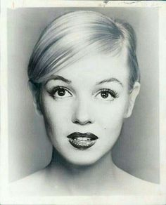 Marilyn Monroe- the only photo so far that I actually find her attractive in (aka not upscale prostitute-ish) lol.