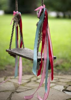 """What a darling way to make your daughter a """"princess swing""""! Might need to replace the ribbons every once in a while due to sun and weather."""