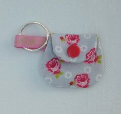 Made in cotton printed fabric, fully lined. A tiny purse with a Kam snap fastener and key ring. Purse Measures 5 cms at the widest point narrowing to X cms high. Grey Roses, Cool Items, Car Parking, Key Rings, Handmade Crafts, Printing On Fabric, Gift Guide, Gifts For Her, September