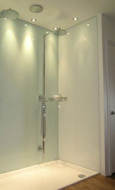 Photograph of shower area fitted with an Opticolour mint white back shower wall panel and Opticolour white side shower wall panels
