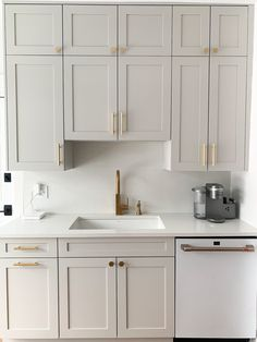 Actual kitchen remodel cost with beautiful, new greige kitchen cabinets (Sherwin Willliams Agreeable Grey), Café Matte White and Gold Hardware Grey Kitchen Cabinets, Kitchen Cabinet Colors, Kitchen Redo, Home Decor Kitchen, Kitchen Interior, Home Kitchens, White Kitchen Appliances, Kitchen Backsplash, Different Color Kitchen Cabinets