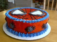 Homemade Spiderman Birthday Cake: I used two 10 round cakes and frosted them red for this Spiderman Birthday Cake.  After smoothing the icing out, I pressed a homemade paper template onto