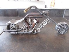 Scrap metal motorcycle welded by JPlaiaSteelArt. Follow JPlaiaSteelArt on Facebook to find and buy more metal art.