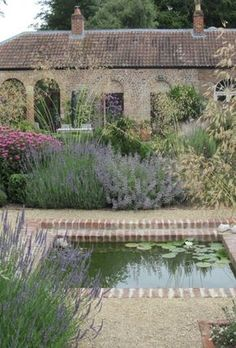 Low maintenance simple garden with Mediterranean flair. Use pea gravel lavender sage grasses catmint coneflower. Fish Pool, Pool Water, Mediterranean Garden Design, Mediterranean Style, Yard Crashers, Walled Garden, Water Features In The Garden, Garden Cottage, Dream Garden
