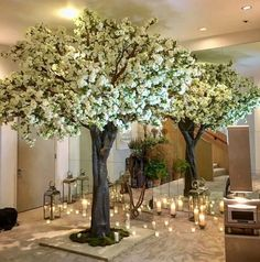 Beautiful large Blossom tree hire from Twilight Trees. Will transform any wedding or event space. An A-List event hire for good reason, this is as good as artificial gets. White Blossom Tree, Blossom Trees, Artificial Indoor Trees, Tree Centerpieces, Tree Base, Tree Wedding, Flowering Trees, Faux Flowers, Wedding Decorations