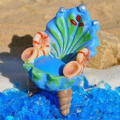 Seashell Chair www.teeliesfairygarden.com . . . Bring a mystical vibe into your garden with this elaborate fairy garden seashell that is befitting for any mermaid royalty. Have it in your garden today! #fairychair