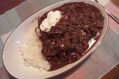Beef stroganoff with sour cream and rice