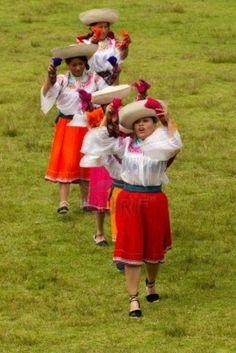 11652525-lloa-ecuador--29-may-2011-group-of-ecuadorian-dancers-dressed-up-in-traditional-costumes-dancing-for