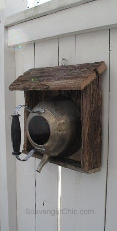 Teakettle birdhouse with reclaimed wood. I was going to toss the old fence boards, but now I know what I'll be doing with them.