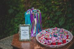 Fun, unique wedding ceremony recessional idea - guests were encouraged to toss multi-colored confetti as the bride + groom walked down the aisle as newlyweds {Ramya J. Images}