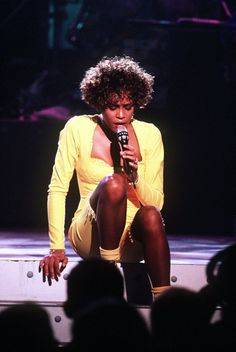 Whitney performing live at the Naval Air Station in Norfolk, Virginia on March 31, 1991. Only 3,100 people were in the audience and all were either military personnel or their families, although HBO made the broadcast available to 53 million at home.