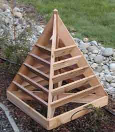 DIY Strawberry Planter Here is great project for the handy gardener. What a clever way to grow strawberries or whatever in a small space. Keep the planter on the deck or patio for convenient access…