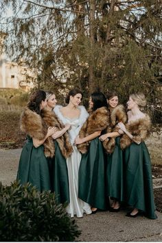 bride tribe goals. fur shawls for a winter wedding