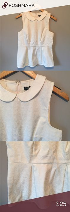J. Crew factory peplum top Lovely top that can be paired with so many things! Nice Peter Pan collar, labeled J. Crew factory with back Zipper. Excellent Condition, no flaws. Labeled a 0 runs big. J. Crew Factory Tops