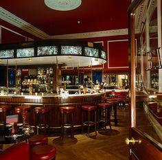 The Horseshoe Bar - The Shelbourne Dublin - Lighting by Lightplan Shelbourne Hotel Dublin, Office Water Cooler, Horseshoe Bar, Cafe Seating, Interior Architecture, Interior Design, Restaurant Bar, Wonderful Places, Bar Stools