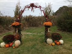 Arch i decorated for a pretty fall wedding