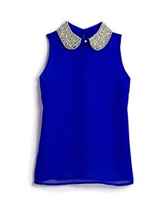 That's what we call a pop of color! This embellished top from @Marshalls is perfect for a holiday party #TheGifter