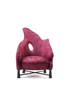 Chair in the De Evolution line by Brad Ascalon Studio, using Dedar fabrics. See more in Color Objects